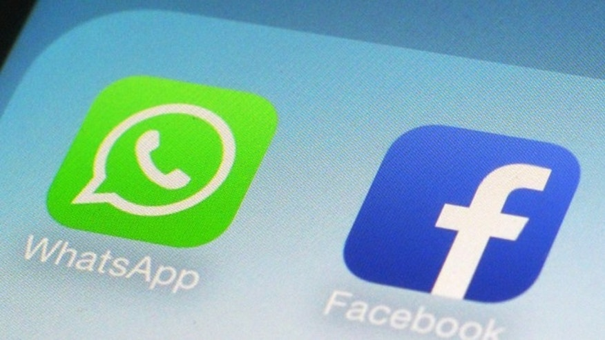 Feb. 19, 2014: The WhatsApp and Facebook app icons seen on an iPhone in New York. On Wednesday the world's biggest social networking company, Facebook, announced it is buying mobile messaging service WhatsApp for up to $19 billion in cash and stock.