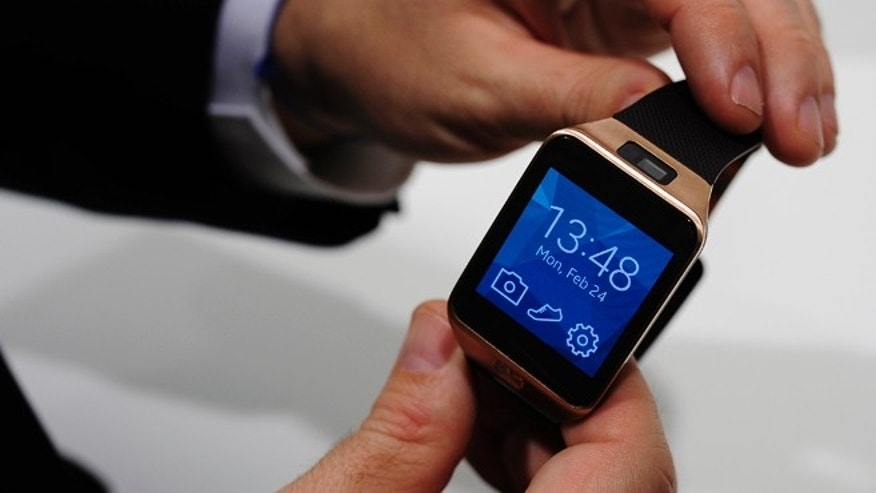 Samsung Gear 2, one of two new computerized wristwatches, this time including health sensors and related fitness features to give people a reason to buy one, is displayed at the Mobile World Congress in Spain.