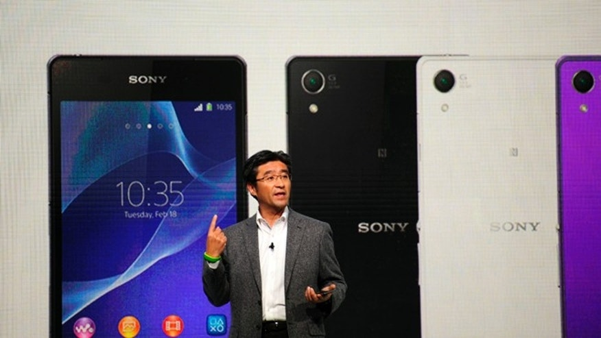 President and CEO of Sony Mobile Communications Kunimasa Suzuki presents the Smartphone Xperia Z2 during the Mobile World Congress, the world's largest mobile phone trade show in Barcelona, Spain, Monday, Feb. 24, 2014.