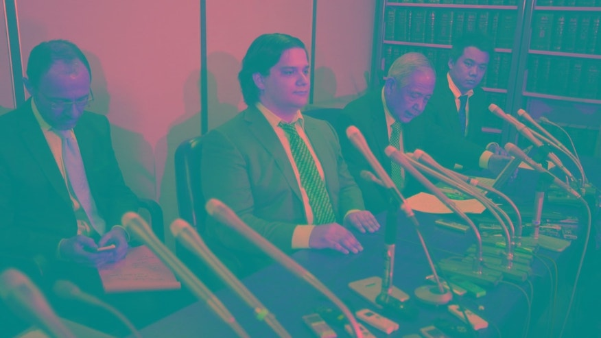 Mark Karpeles (L), chief executive of Mt. Gox, attends a news conference at the Tokyo District Court in Tokyo Feb. 28, 2014. The hackers uploaded a series of files that included a spreadsheet of anonymous user accounts with balances.