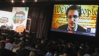 March 10, 2014: Edward Snowden talks during a simulcast conversation during the SXSW Interactive Festival in Austin, Texas. Snowden talked with American Civil Liberties Union's principal technologist Christopher Soghoian, and answered tweeted questions.