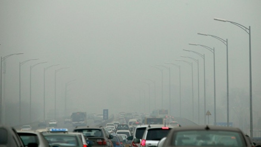Feb. 26, 2014: Cars travel on an overpass amid thick haze in the morning in Beijing. China's north is suffering a pollution crisis, with the capital Beijing itself shrouded in acrid smog.