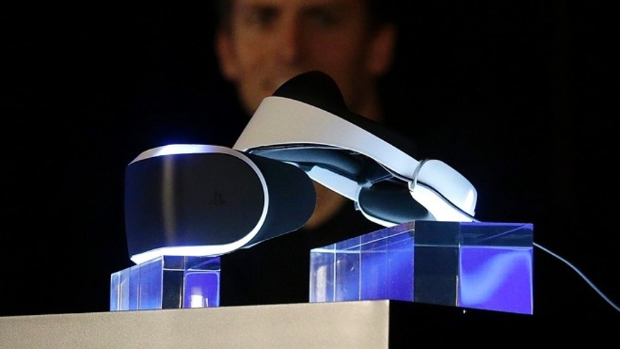 March 18, 2014: The PlayStation 4 virtual reality headset Project Morpheus is shown on stage as Richard Marks, senior director of research and development at Sony Computer Entertainment America, answers questions at the Game Developers Conference 2014 in San Francisco.