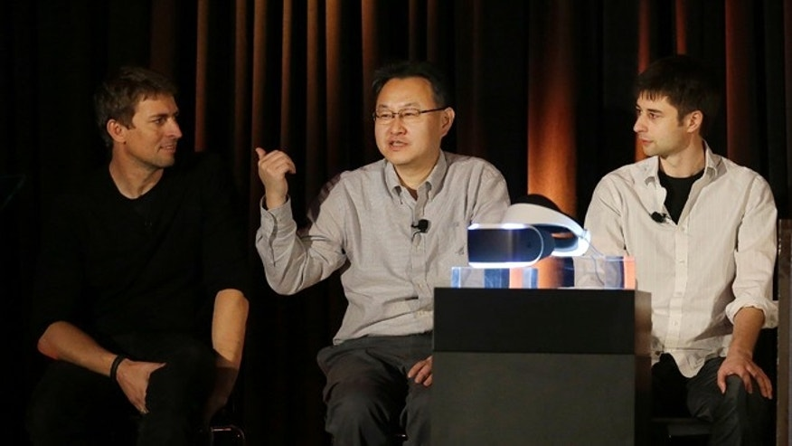 March 18, 2014: Richard Marks, senior director of research and development at Sony Computer Entertainment America, from left, Shuhei Yoshida, president, and Anton Mikhailov, senior software engineer, answer questions about the PlayStation 4 virtual reality headset Project Morpheus at the Game Developers Conference 2014 in San Francisco.