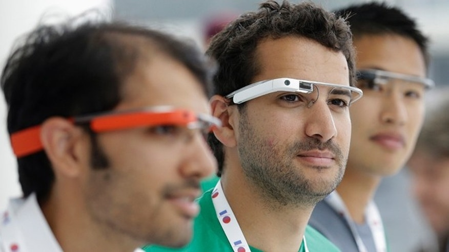 May 15, 2013: Google Glass team members wear Google Glasses at a booth at Google I/O 2013 in San Francisco.