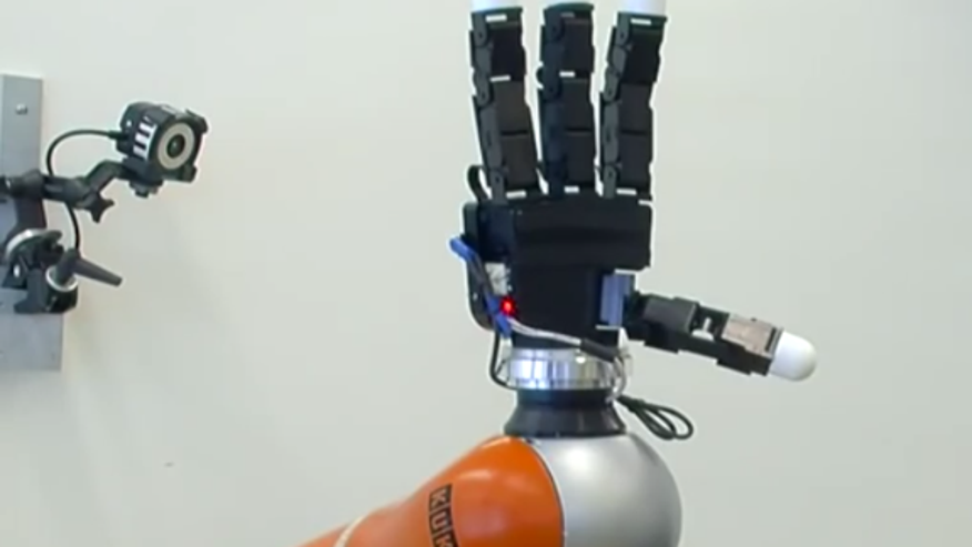 The robot arm can catch objects such as a ball, bottle or tennis racket.
