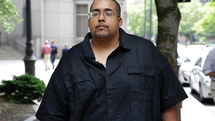 Hector Xavier Monsegur leaves court in New York, Tuesday, May 27, 2014.