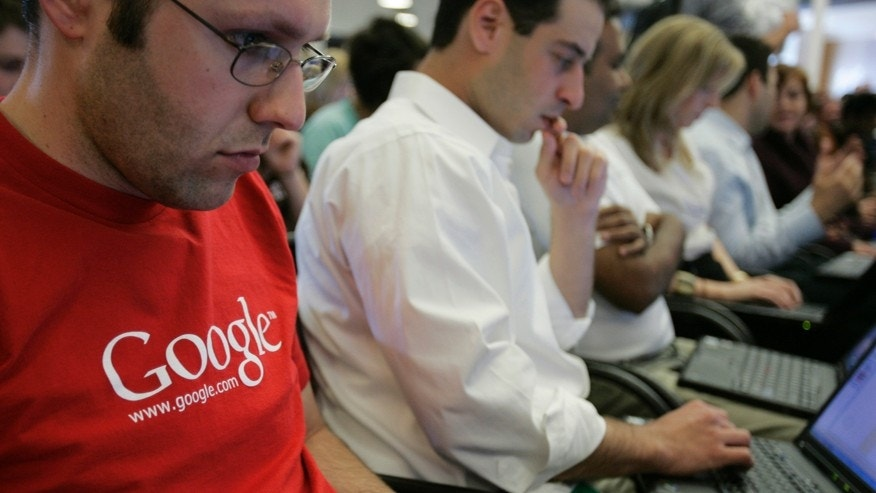 In this May 30, 2007 file photo, Google employees work on their laptops at Google headquarters in Mountain View, California.