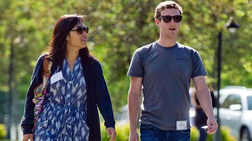 Mark Zuckerberg, president and CEO of Facebook, and his wife Priscilla Chan