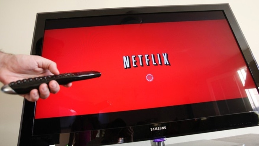 In this July 20, 2010 file photo, a person uses Netflix in Palo Alto, Calif.