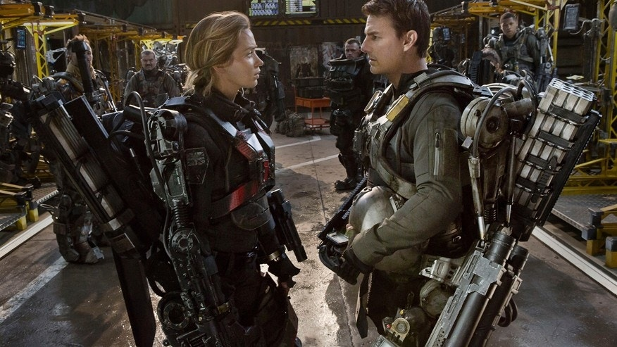 "This photo released by Warner Bros. Pictures shows, Emily Blunt, left, as Rita and Tom Cruise as Cage, in Warner Bros. Pictures' and Village Roadshow Pictures' sci-fi thriller ""Edge of Tomorrow."""