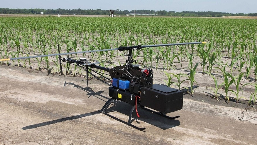 In this Monday, May 19, 2014 photo, an unmanned aerial vehicle equipped with a multi-spectral camera awaits takeoff at the Southeastern Agricultural Center's research farm in Moultrie, Ga.