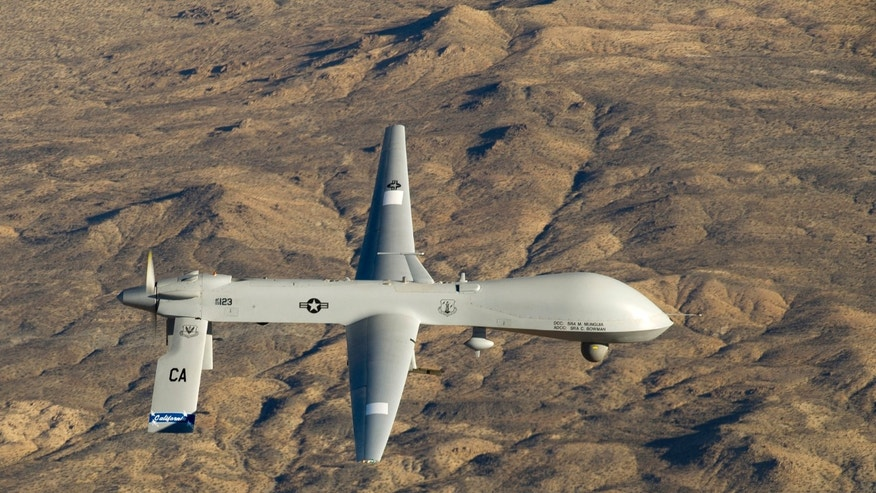 A U.S. Air Force MQ-1 Predator unmanned aerial vehicle assigned to the California Air National Guard's 163rd Reconnaissance Wing flies near the Southern California Logistics Airport in Victorville, California in this January 7, 2012 USAF handout photo obtained by Reuters February 6, 2013.    REUTERS/U.S. Air Force/Tech. Sgt. Effrain Lopez/Handout     (UNITED STATES - Tags: MILITARY POLITICS) THIS IMAGE HAS BEEN SUPPLIED BY A THIRD PARTY. IT IS DISTRIBUTED, EXACTLY AS RECEIVED BY REUTERS, AS A SERVICE TO CLIENTS. FOR EDITORIAL USE ONLY. NOT FOR SALE FOR MARKETING OR ADVERTISING CAMPAIGNS - RTR3DF74