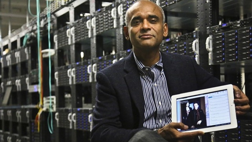 FILE - This Dec. 20, 2012 file photo shows Chet Kanojia, founder and CEO of Aereo, Inc., holding a tablet displaying his company's technology, in New York.  The Supreme Court has ruled that a start-up Internet company has to pay broadcasters when it takes television programs from the airwaves and allows subscribers to watch them on smartphones and other portable devices. The justices said Wednesday by a 6-3 vote that Aereo Inc. is violating the broadcasters' copyrights by taking the signals for free. The ruling preserves the ability of the television networks to collect huge fees from cable and satellite systems that transmit their programming. (AP Photo/Bebeto Matthews, File)