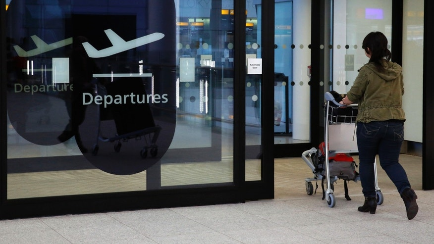 A passenger enters departures in Terminal 2 at Heathrow Airport in London July 3, 2014.