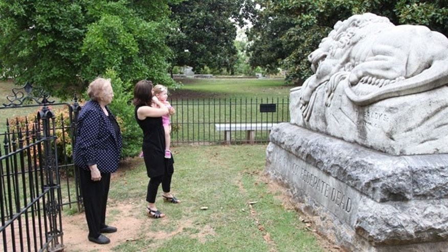 July 18, 2014: Janice Reed, her daughter Nancy Reed Morris, and her granddaughter Megan Morris, from left, visit the Confederate unknown soldier monument at Historic Oakland Cemetery while taking a Battle of Atlanta mobile app tour in Atlanta.