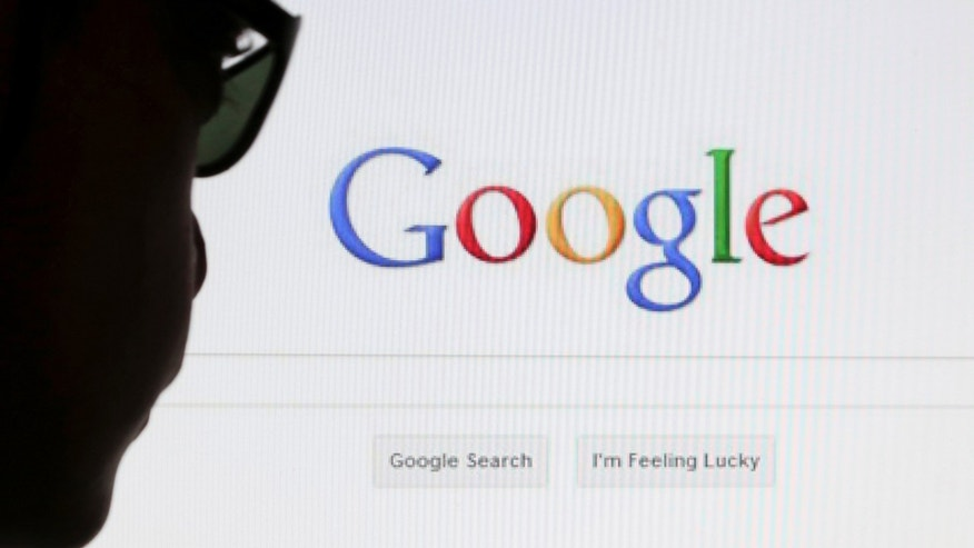 A computer user poses in front of a Google search page in this photo illustration taken in Brussels May 30, 2014. Google has taken the first steps to meet a European ruling that citizens can have objectionable links removed from Internet search results, a ruling that pleased privacy campaigners but raised fears that the right can be abused to hide negative information.   REUTERS/Francois Lenoir (BELGIUM - Tags: POLITICS SCIENCE TECHNOLOGY) - RTR3RK9T