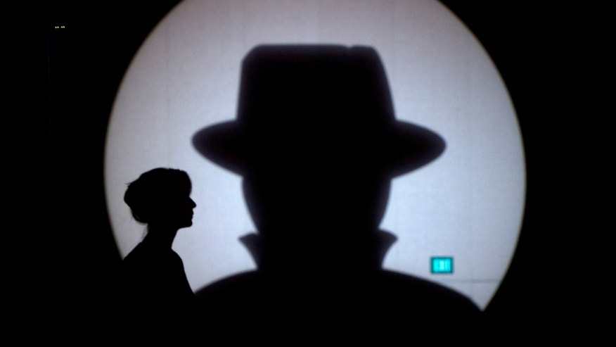Speaker liaison Genevieve Netter is silhouetted against a Black Hat logo during the Black Hat USA 2014 hacker conference at the Mandalay Bay Convention Center in Las Vegas, Nevada August 6, 2014. REUTERS/Steve Marcus (UNITED STATES - Tags: SCIENCE TECHNOLOGY TPX IMAGES OF THE DAY) - RTR41H1N