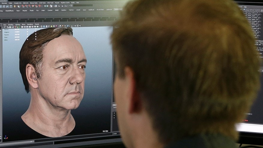 "This July 31, 2014 photo shows senior technical artist Mason Sheffield working on the face of actor Kevin Spacey for the new ""Call of Duty: Advanced Warfare"" game at Sledgehammer Games in Foster City, Calif."