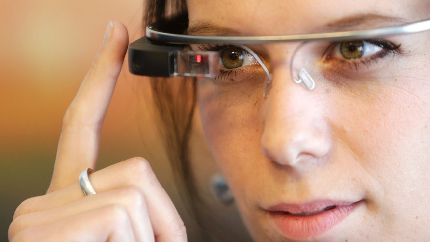 A woman wears Google glasses after a media presentation of a Google apartment in Prague May 15, 2014.