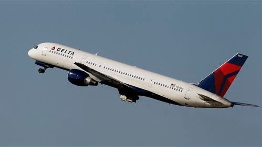 File photo of a Boeing 757 taking off  in Tampa, Fla.