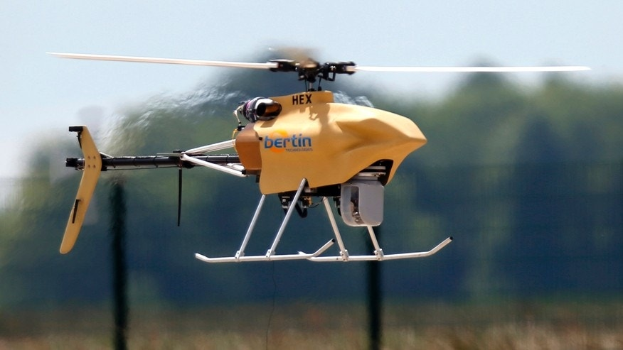 An Hovereye-Ex drone flies during an exhibition at Bretigny-sur-Orge, near Paris, May 14, 2014. REUTERS/Charles Platiau