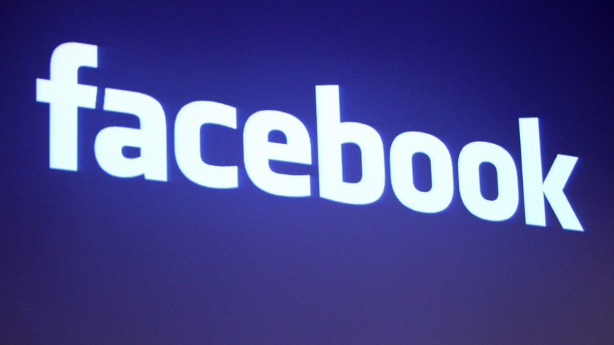 The Facebook logo is shown at Facebook headquarters in Palo Alto, California.