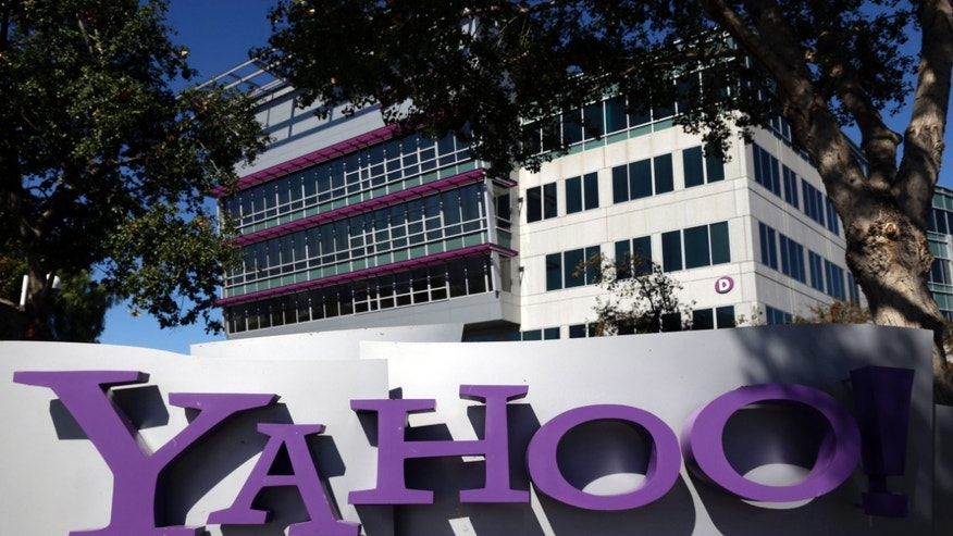 FILE - This Oct. 17, 2012, photo, shows a sign in front of Yahoo! headquarters in Sunnyvale, Calif. Yahoo says the government threatened to fine the company $250,000 a day if it did not comply with demands to go along with an expansion of U.S. surveillance laws by surrendering online information, a step the company regarded as unconstitutional. (AP Photo/Marcio Jose Sanchez, File)