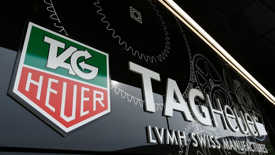 The Tag Heuer logo is seen at the entrance of their new watch manufactory in Chevenez November 5, 2013. Swiss watch brand TAG Heuer expects single-digit sales growth this year and is aiming to outperform market growth estimated at about 5 percent in 2014, its head told Reuters on Tuesday. REUTERS/Ruben Sprich  (SWITZERLAND - Tags: BUSINESS) - RTX1517Z