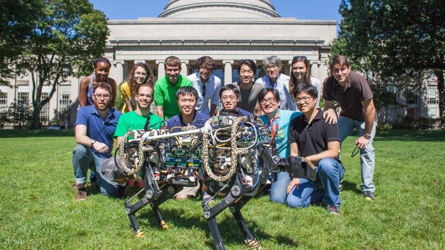 MIT Biomimetic Robotics Laboratory members pose with the MIT cheetah robot in Killian Court.