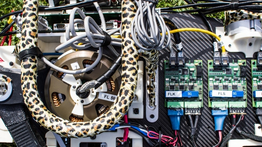 The custom, high-torque-density motors and amplifier on the MIT cheetah-bot.