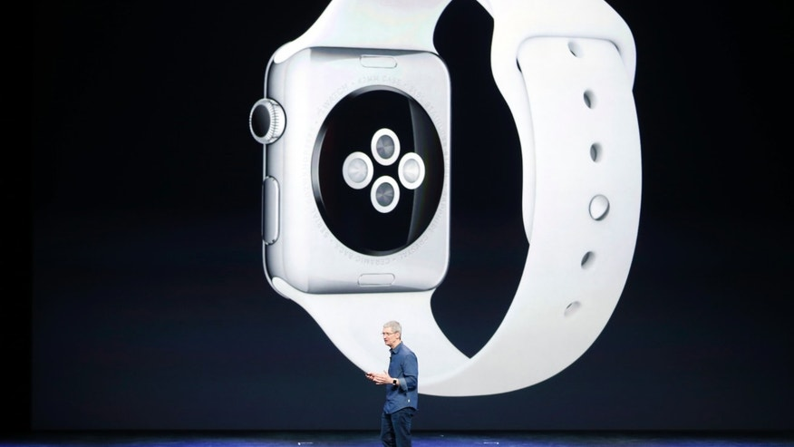 Apple CEO Tim Cook speaks during an Apple event announcing the iPhone 6 and the Apple Watch at the Flint Center in Cupertino, California, September 9, 2014. REUTERS/Stephen Lam (UNITED STATES - Tags: BUSINESS SCIENCE TECHNOLOGY) - RTR45LH4