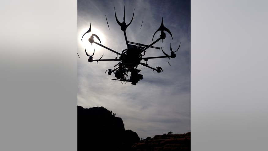 This image provided by Aerial MOB, LLC, shows their eight rotor Sky Jib Helicopter in San Diego, Calif., in August 2013.