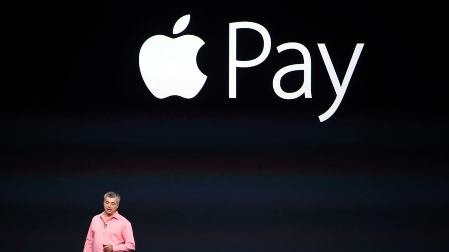 Eddy Cue, Apple's senior vice president of Internet Software and Service, introduces Apple Pay during an Apple event at the Flint Center in Cupertino, California, September 9.