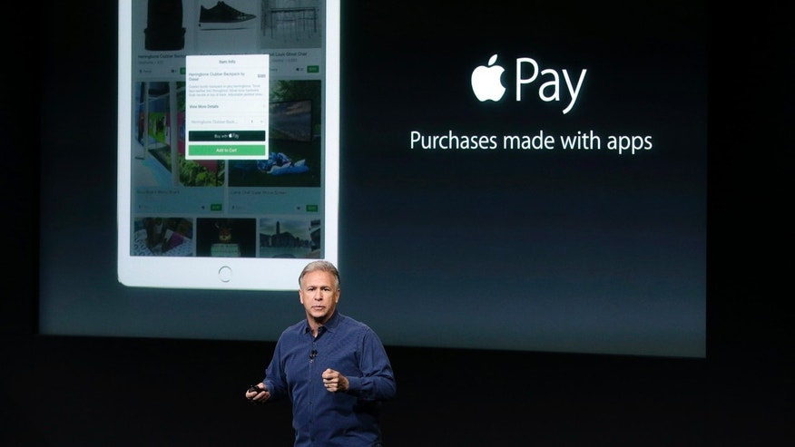Phil Schiller, Apple's senior vice president of worldwide product marketing, discuss the features of the new Apple iPad Air 2 and Apple Pay during an event at Apple headquarters on Oct. 16, 2014.