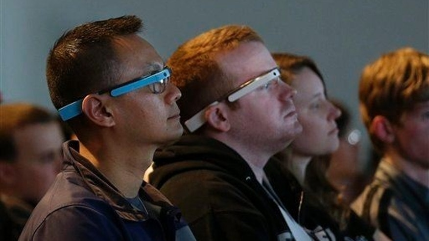 Attendees wear Google Glass during the Google I/O 2014 keynote presentation in San Francisco on June 25, 2014.