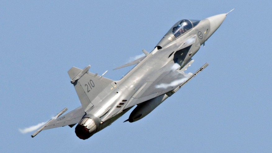 A Saab JAS 39C Gripen jet performs during an aerial show in Eslov, Sweden, in this file photo.