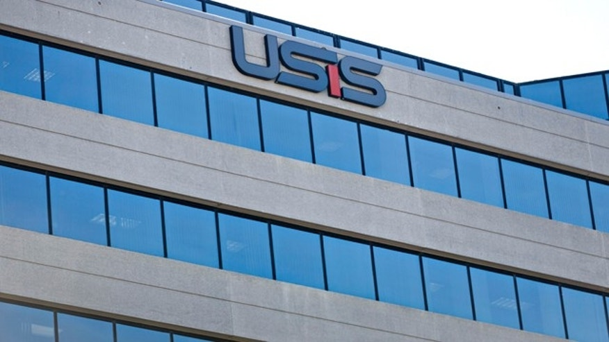 October 17, 2014: This photo shows the USIS building in Falls Church, Va. A cyber-attack similar to previous hacker intrusions from China penetrated computer networks for months at USIS, the governments leading security clearance contractor, before the company noticed the break-in, officials and others familiar with an FBI investigation and related official inquiries told The Associated Press. (AP Photo/J. Scott Applewhite)