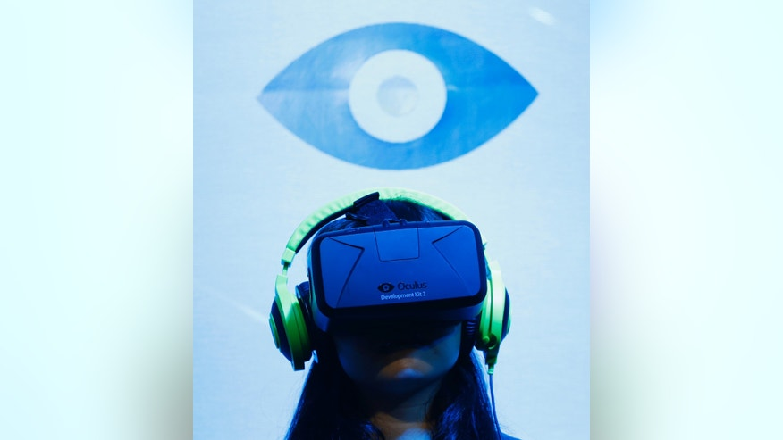 A woman tries out out Oculus VR's headset Oculus rift development kit 2 at its booth in Tokyo Game Show 2014 in Makuhari, east of Tokyo September 18, 2014.