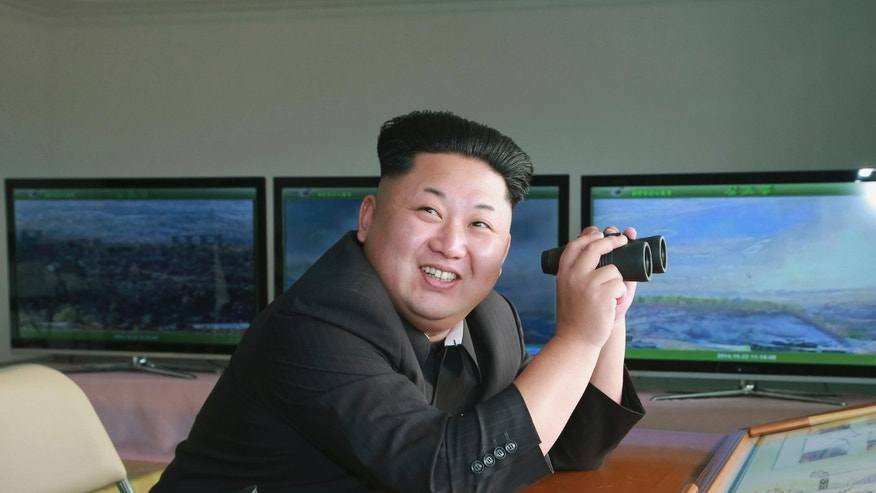 North Korean leader Kim Jong Un attends a military drill at an undisclosed location in this undated photo released by North Korea's Korean Central News Agency.