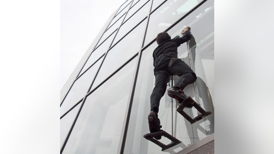 Stanford graduate student Elliot Hawkes demonstrates a new hand-sized gecko-inspired adhesive device that allows a human to climb a glass wall like a gecko.