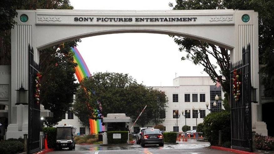 FILE - In this Dec. 2, 2014 file photo, cars enter Sony Pictures Entertainment headquarters in Culver City, Calif. (AP Photo/Nick Ut, File)