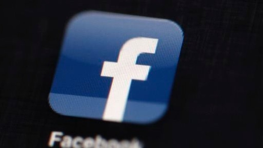 This May 16, 2012 file photo shows the Facebook logo displayed on an iPad in Philadelphia.
