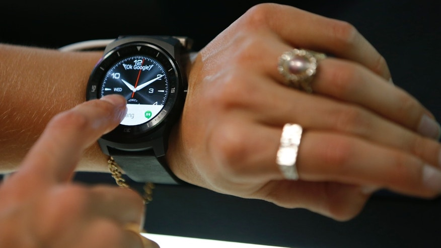 An LG G Watch R smartwatch is presented at the IFA consumer technology fair in Berlin.