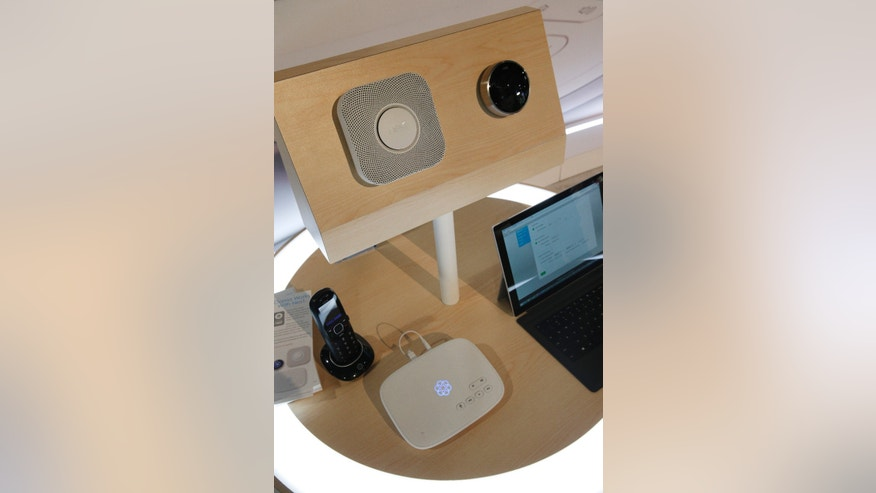 An Ooma Telo, center on bottom, is on display with nest devices, top, at the Ooma during the International CES Thursday, Jan. 8, 2015, in Las Vegas.