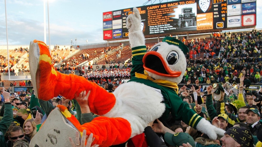 University of Oregon Ducks' mascot celebrates with fans after their win over the Oregon State Beavers in NCAA football game in Corvallis, Oregon, December 4, 2010.