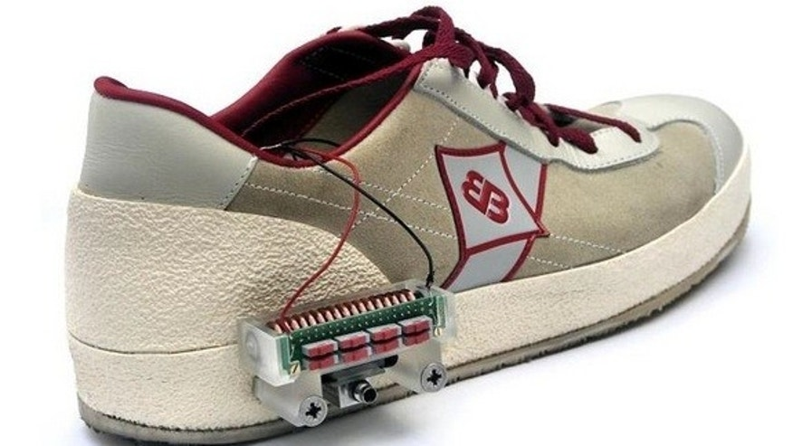 This energy harvesting device is mounted on the outside of a sneaker, but such devices can also be embedded in the heel of a shoe to harvest energy as a person walks or runs.