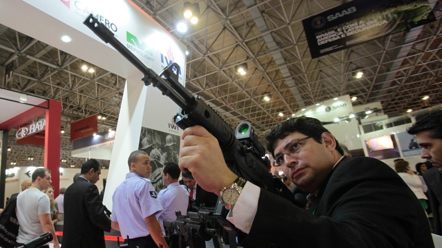 File photo - a man holds a Galil ACE 31 assault rifle at the Defence and Security International Exhibition Latin America Aero and Defence (LAAD) trade show for the defence and security industry in Latin America, in Rio de Janeiro April 9, 2013.