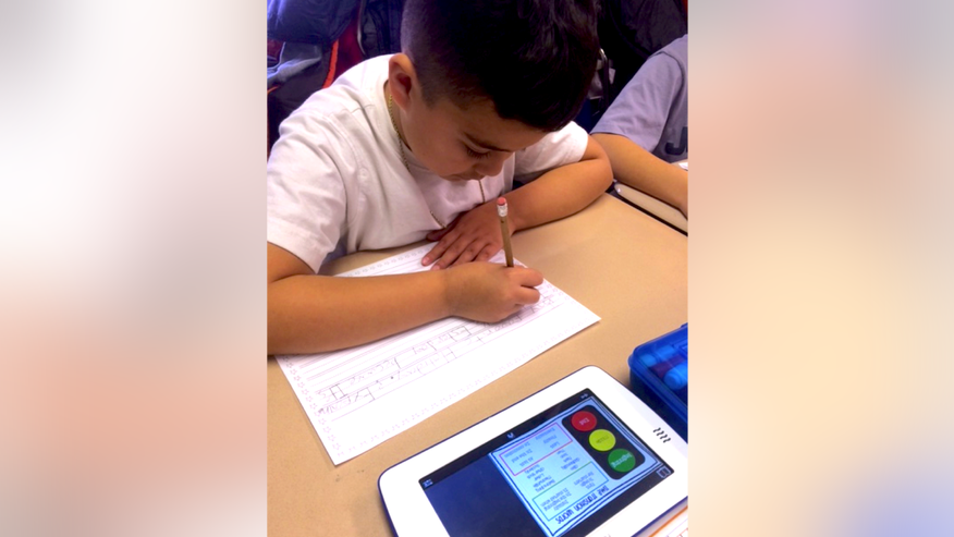 A student uses the Fable tablet in Furnell McGrath's second grade classroom at Webster School in Everett, Mass.