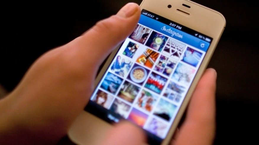 File-This April 9, 2012, file photo shows Instagram being demonstrated on an iPhone in New York. (AP Photo/Karly Domb Sadof, File)